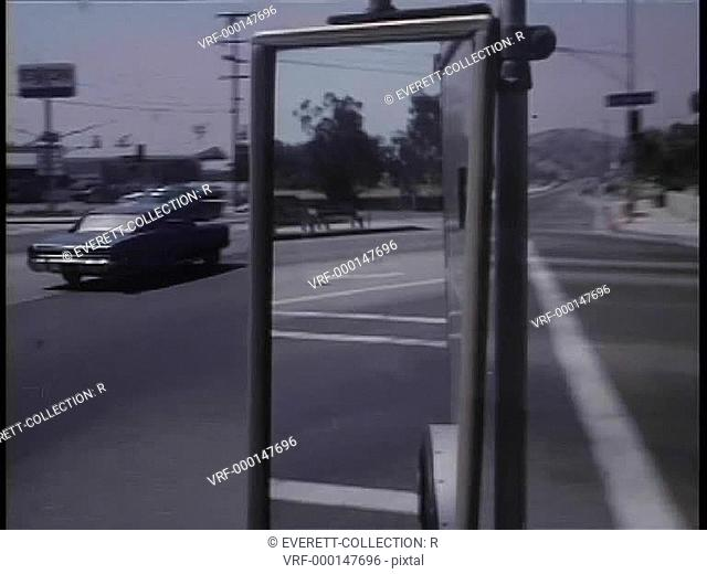 View from side view mirror as car turns