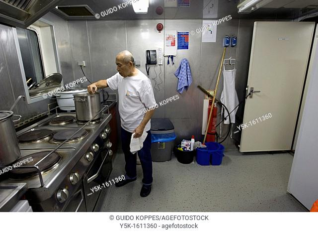 During the voyage of the MV Flintercape from Rotterdam, Netherlands to Sundsvall, Sweden, this Indonesian cook takes care of all the food and meals on board