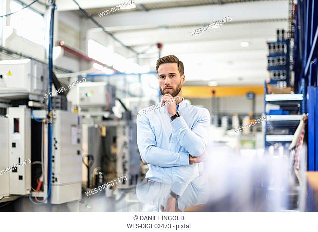 Young businessman in factory