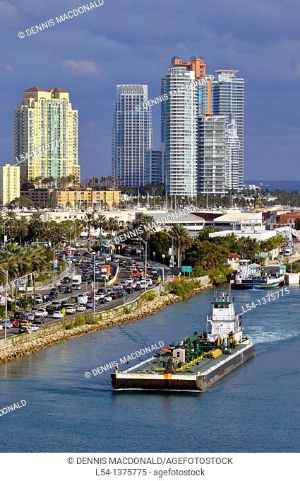 Tug boat moving barge in Miami Florida harbor