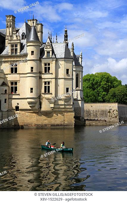 Two people in a canoe by the Turreted Pavilion, Chateau Chenonceau, Loire Valley, France
