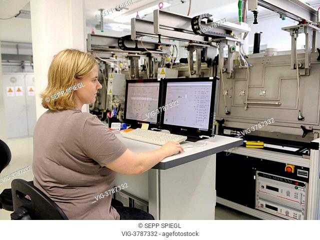 Germany, Gelsenkirchen, The Laboratory and Service Center (LSC) of the Fraunhofer Institute for Solar Energy Systems. Laboratory technician working on the...