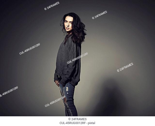 Woman wearing baggy sweatshirt