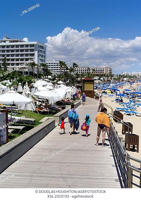 Fig Tree Bay PROTARAS CYPRUS Family on boardwalk promenade sandy