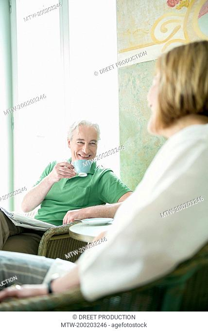 Couple drinking coffee, smiling