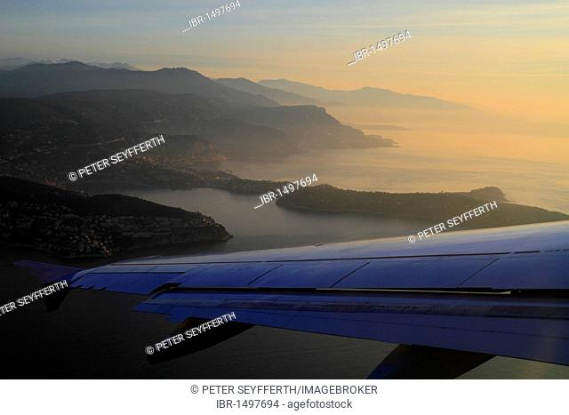 Aerial picture of Cap Ferrat and the coast of Côte d'Azur up to Monaco, just after sunrise, Alpes Maritimes, Région Provence Alpes Côte d'Azur, France