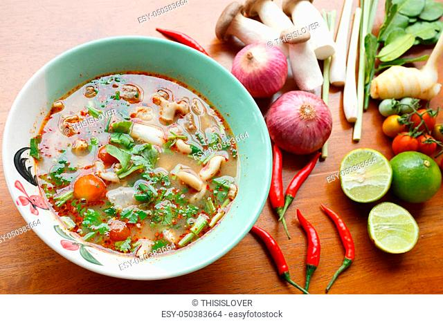 Hot & spicy soup with pork and chilli paste Ingredient on wooden table