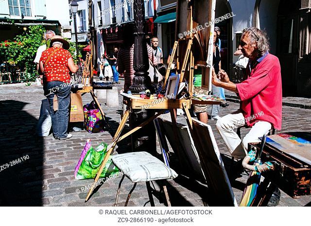 Artists painting in Place du Tertre square. Montmartre, Paris, Ile de France, France