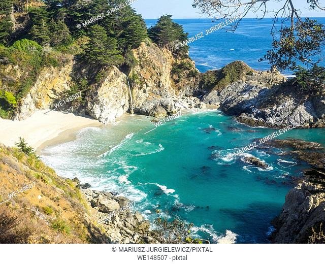McWay Falls is an 80-foot waterfall located in Julia Pfeiffer Burns State Park that flows year-round