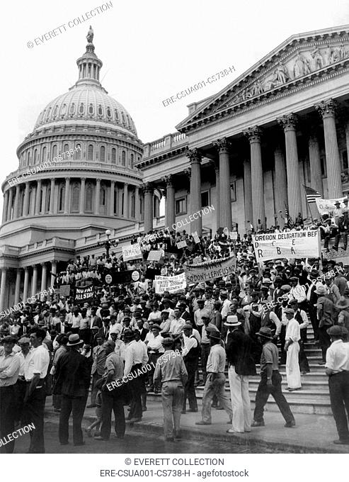 Bonus Army protests at the Capitol. 'Demand Congress Enact Relief Before Adjournment' reads one sign of Bonus Army Veterans. July 2, 1932