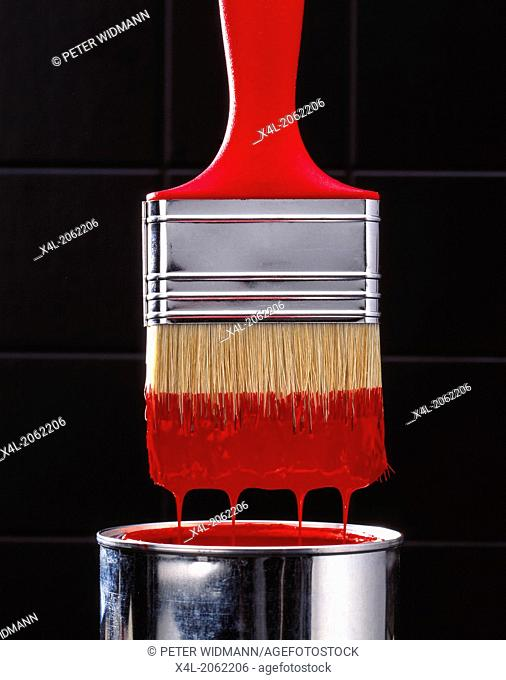 Brush with red paint