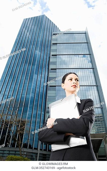 Low angle view of a businesswoman holding files