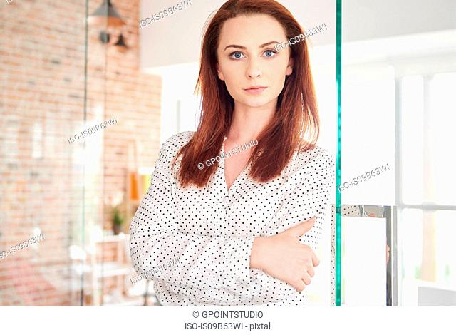 Portrait of businesswoman arms folded looking at camera