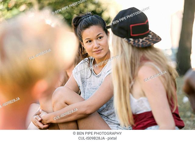 Female friends chatting in park