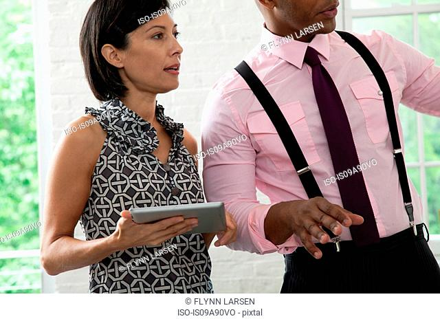 Office colleague holding digital tablet in meeting