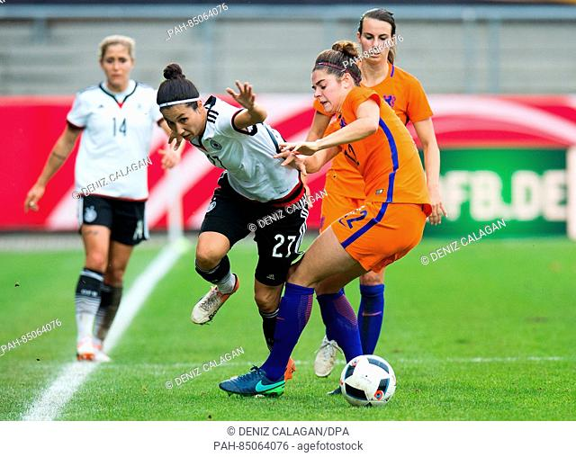 Germany's Sara Doorsoun (L) and the Netherland's Tessel Middag vie for the ball during the women's international soccer match between Germany and the...