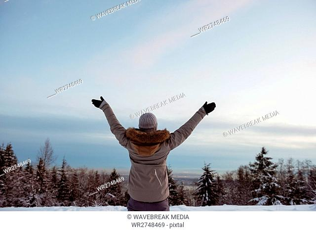Woman standing with her arms wide open
