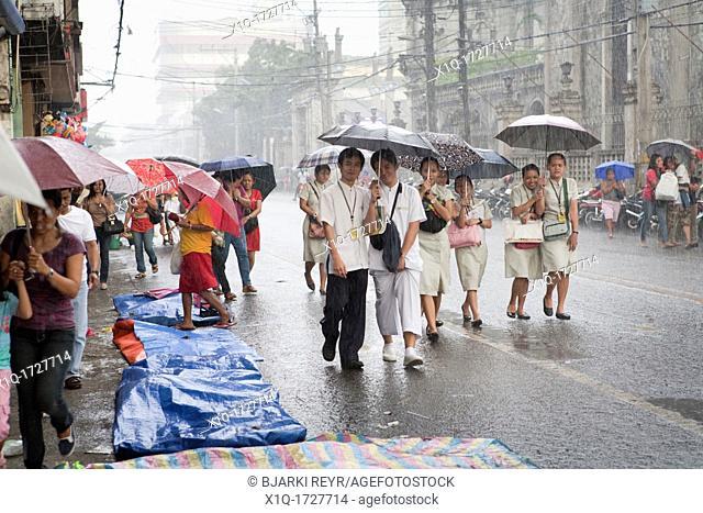 College students walking during a heavy downpour  Cebu City, Cebu, Visayas, Philippines