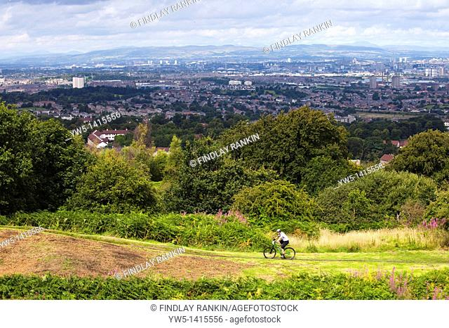 Mountain bike rider riding during a race at Cathkin Braes, Glasgow, Scotland, UK