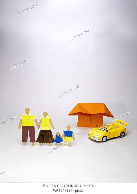 origami family icon in front of house and sport car India Asia