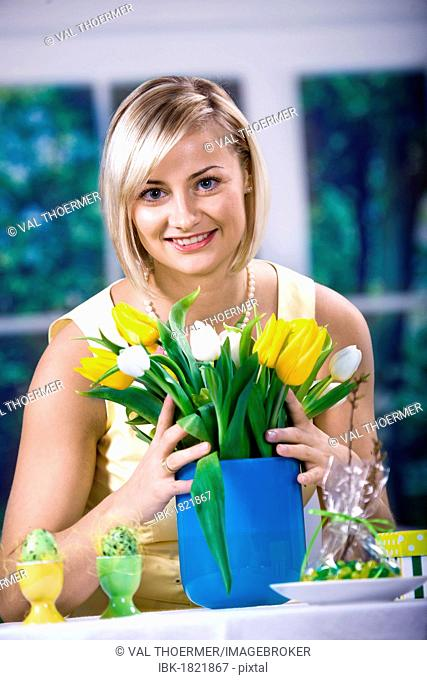 Woman with tulips and Easter eggs