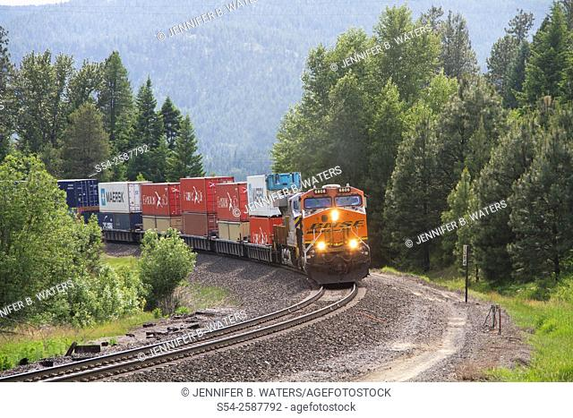 A BNSF train running on the BNSF line near Naples, north Idaho, USA