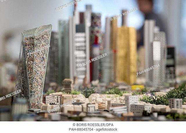 The plexi glas reconstruction of the European Central Bank is filled with shredded bank notes in the new model of the city of Frankfurt, Germany