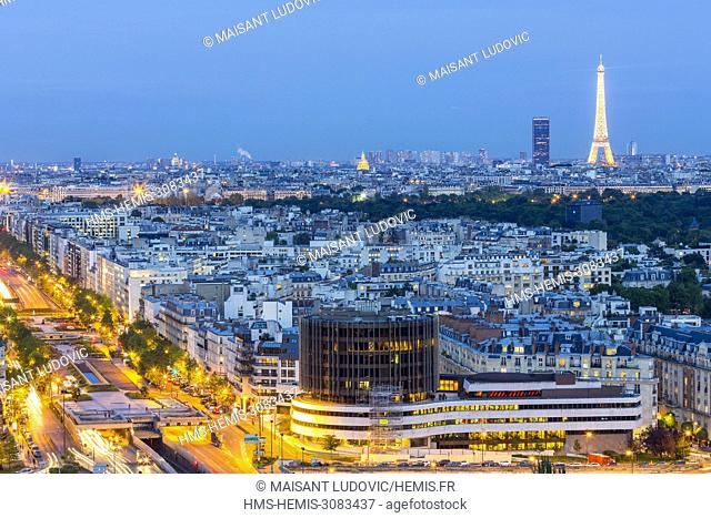 France, Paris, overlooking the Neuilly sur Seine bridge, the Bois de Boulogne, the Eiffel Tower (1889) and the Montparnasse Tower (1973)