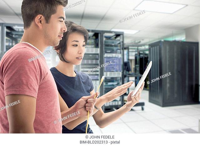 Business people working in server room