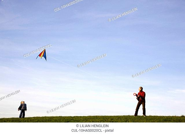 Boy and Girl fly a Kite