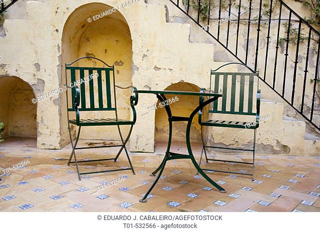 solitary table and chairs in Andalusian patio