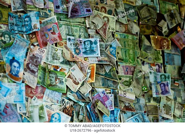 Decorated wall of money from all countries of the world