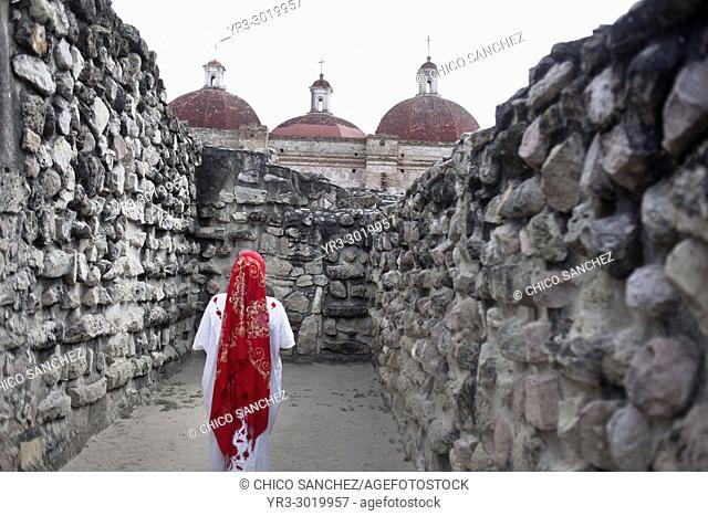 A woman wearing Oaxaca's indigenous clothing walks in Mitla archaeological site in Oaxaca, Mexico