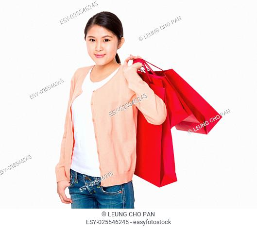 Young woman hand hold with shopping bag