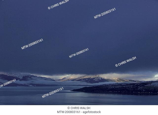 Mountain landscape stormy snow dark sky winter