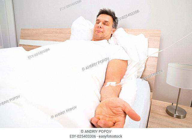 Patient Resting On Bed With Iv Drip In Hospital