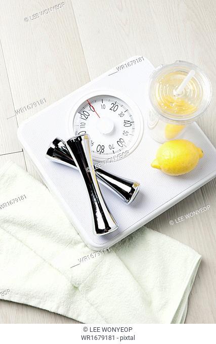 a couple of lemons on a scale