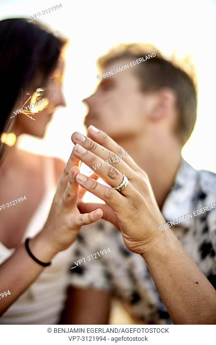 Sensual couple touching fingers, love, emotions, relationship. Chersonissos, Crete, Greece