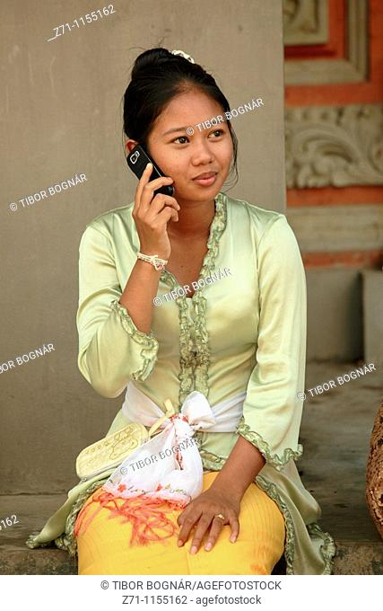 Indonesia, Bali, Mas, temple festival, young woman, mobile phone, odalan, Kuningan holiday