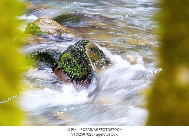 Flowing water and solid rock, Curak river, Zeleni vir in Croatia