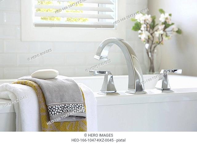 Contemporary bathtub and towels