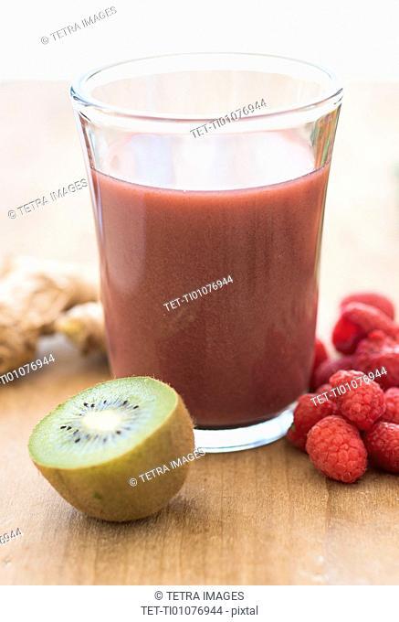 Studio shot of kiwi and raspberry juice