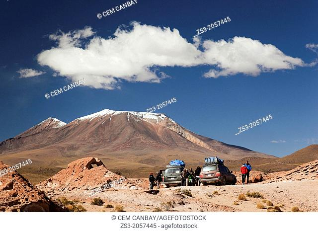 Tourists and guides near the 4x4 jeeps during a break, Salar de Uyuni, Southern Altiplano, Bolivia