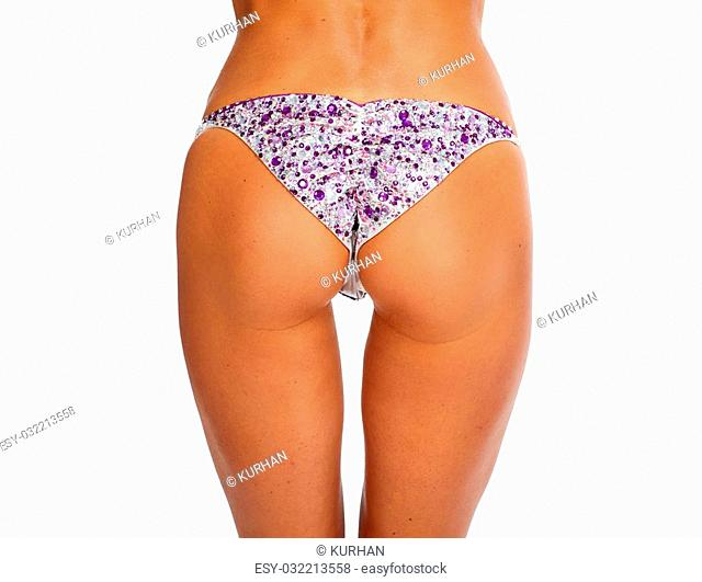 Young beautiful athletic girl buttocks in bikini. Sport and fitness concept