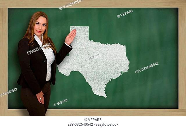 Successful, beautiful and confident young woman showing map of texas on blackboard for presentation, marketing research and tourist advertising