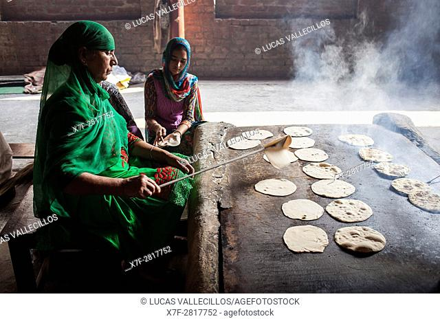 Making chapatis. Volunteers cooking for the pilgrims who visit the Golden Temple, Each day they serve free food for 60,000 - 80,000 pilgrims, Golden temple