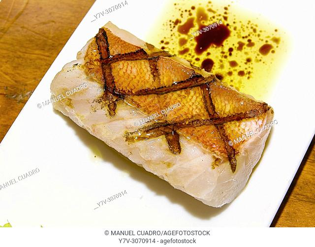 Pintxo de Lomo de cabracho de Bermeo con vinagreta de Módena. Restaurante Mendizabal. Biscay, Basque Country, Spain