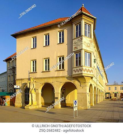 Corner building with Roland statue at the market square of Prenzlau, Brandenburg, Germany