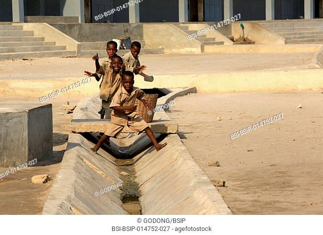 Togolese children playing in the gutter. Primary School Adjalle