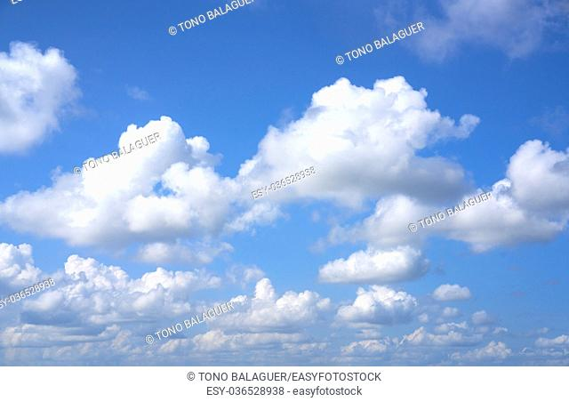 Blue summer sky white cumulus clouds background
